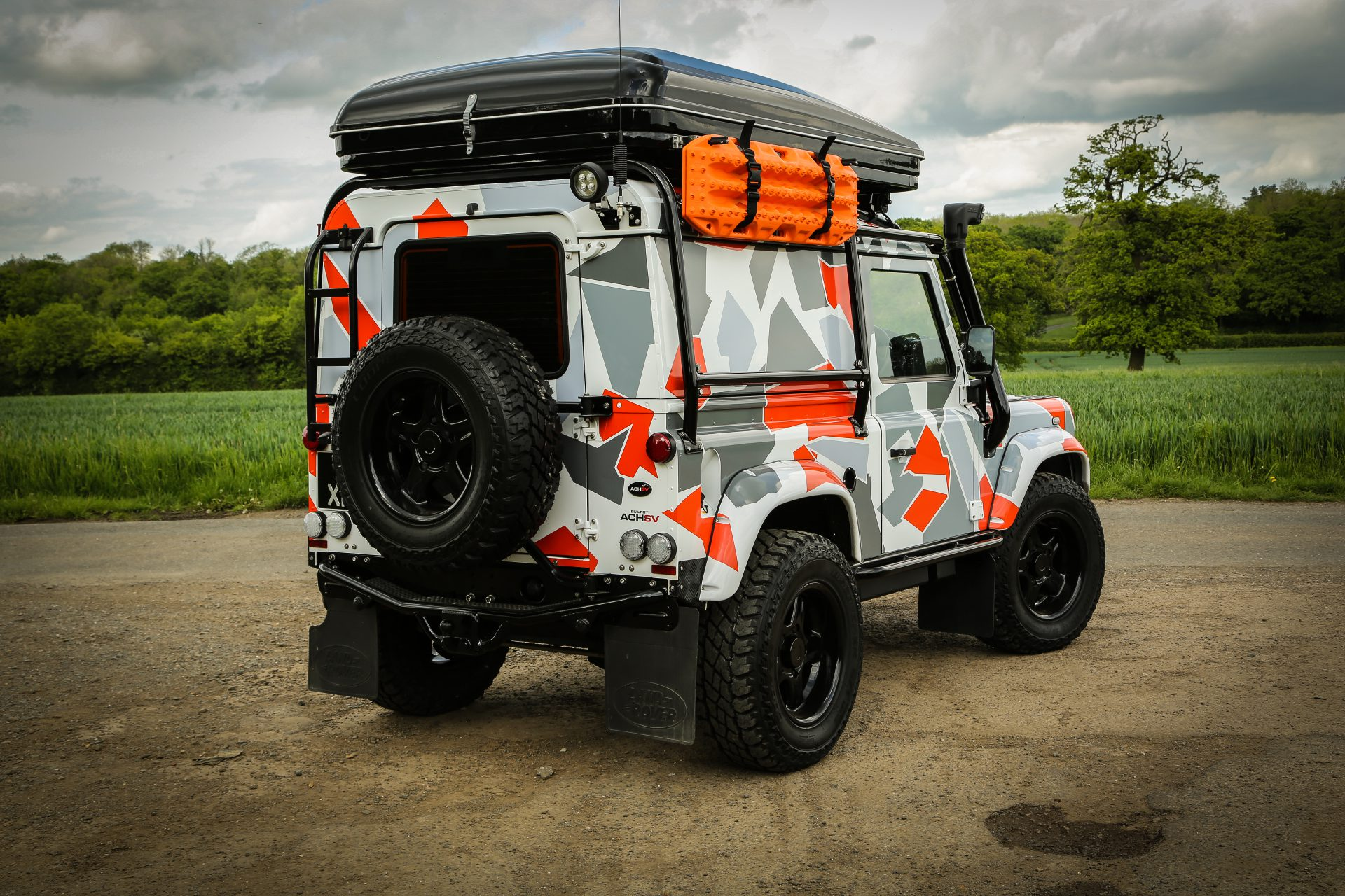 Land Rover Defender 90 Custom Build by ACHSV 4x4 - Overflowing with 4x4 accessories, riding on Air Suspension and finished in Arctic camouflage effect paintwork